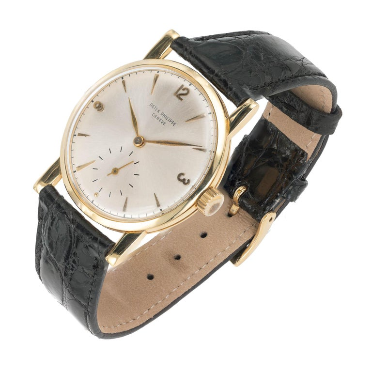 Patek Philippe 18k Yellow Gold Wristwatch, Ref. 1578, circa 1955  18k yellow gold Length: 41.75mm Width: 34.86mm Strap width at case: 20mm Case thickness: 8.8mm Dial: Silvered  Inside case: 1578 750 675924 Movement: Adjusted 5 positions