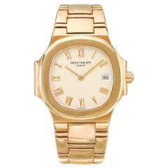 Patek Phillipe Ref 4700 Nautilus Yellow Gold Bracelet Watch with Date, 1993
