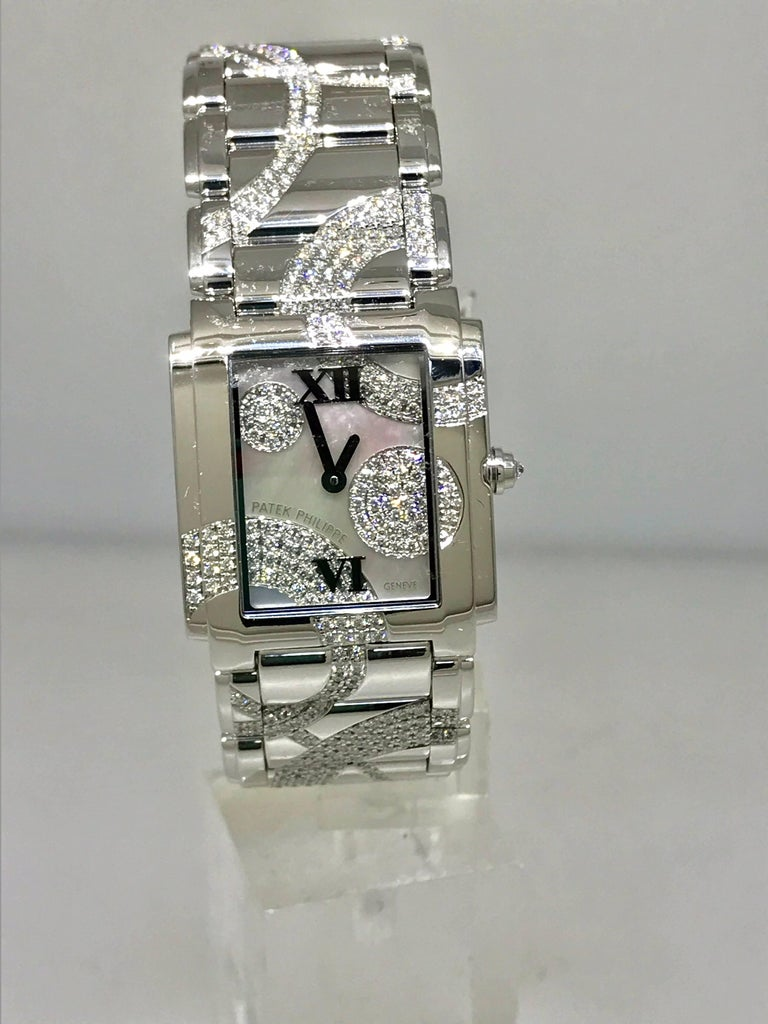 Patek Phillipe Twenty-4 Women's Watch  Model Number: 4910/49G-001  100% Authentic  Brand New (Old Stock)  Comes with original Patek Phillipe box, warranty (open papers), tag, and instruction manual in leather pouch  18 Karat White Gold Case &