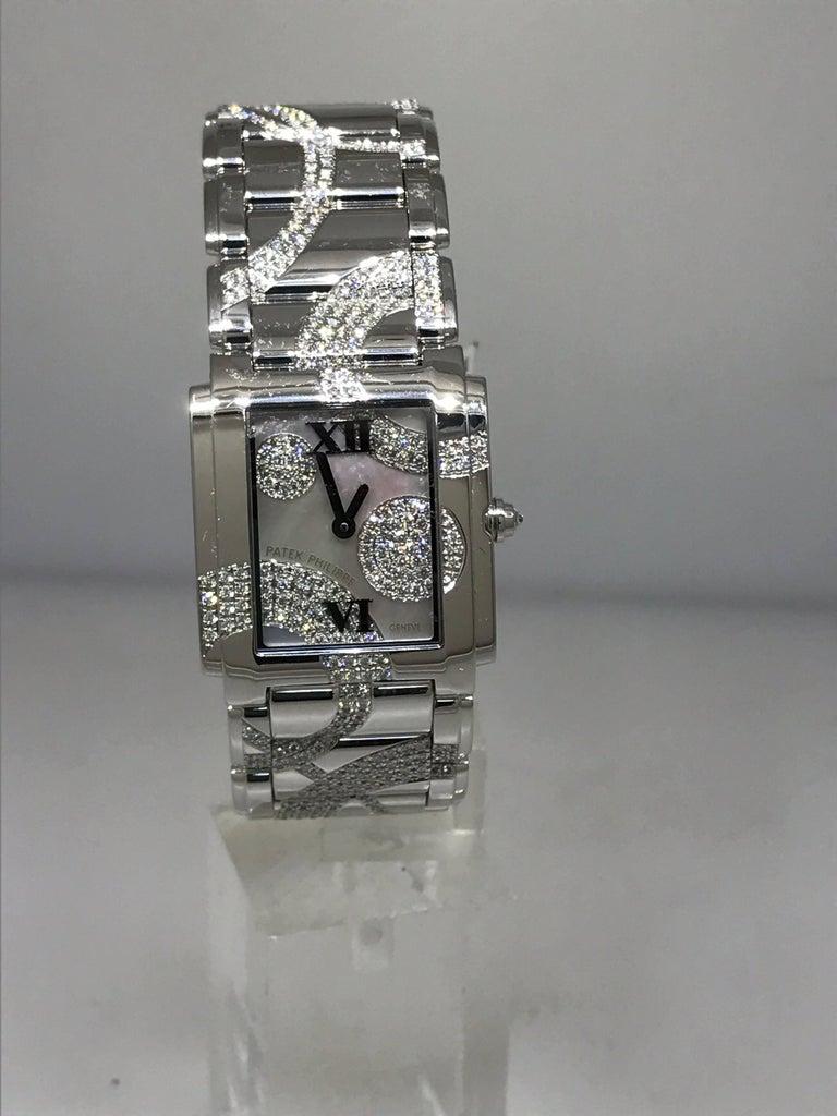 Patek Philippe Ladies White Gold Diamond Twenty-4 Bracelet Wristwatch 4910/49g In New Condition For Sale In New York, NY