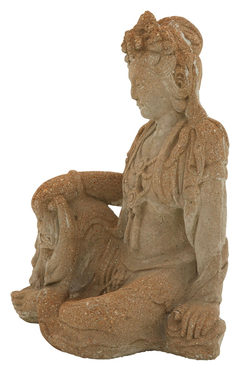 • Statue of the female Buddha, also known as Tara • Cement • Patinated finish • 20th century • American. • Measures: 22