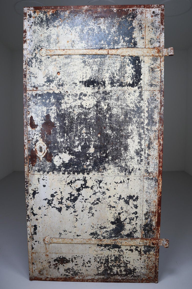 This strong patinated 19th century door from France are constructed from iron. Perfect to incorporate in a industrial interior or as a decorative object and would make an eye-catching addition to any interior. Fabulous patina.