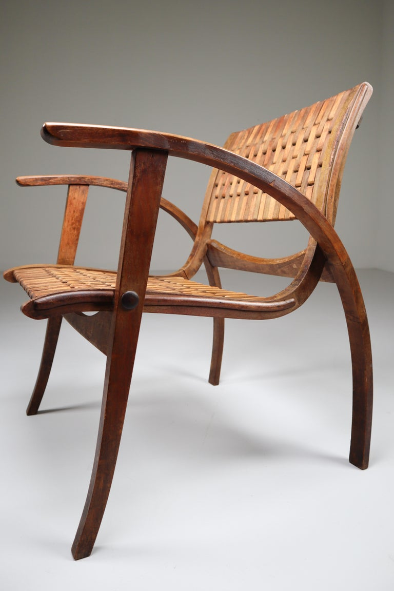 Patinated Bauhaus lounge chair designed by Erich Dieckmann, manufactured by Gelanka Tyskland in Germany, circa 1930. Made of high quality bent beech plywood with webbed seats and back, a beautiful combination of materials that work really well for
