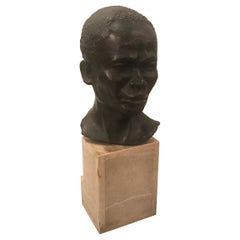 Patinated Bronze and Marble African Male Bronze Bust
