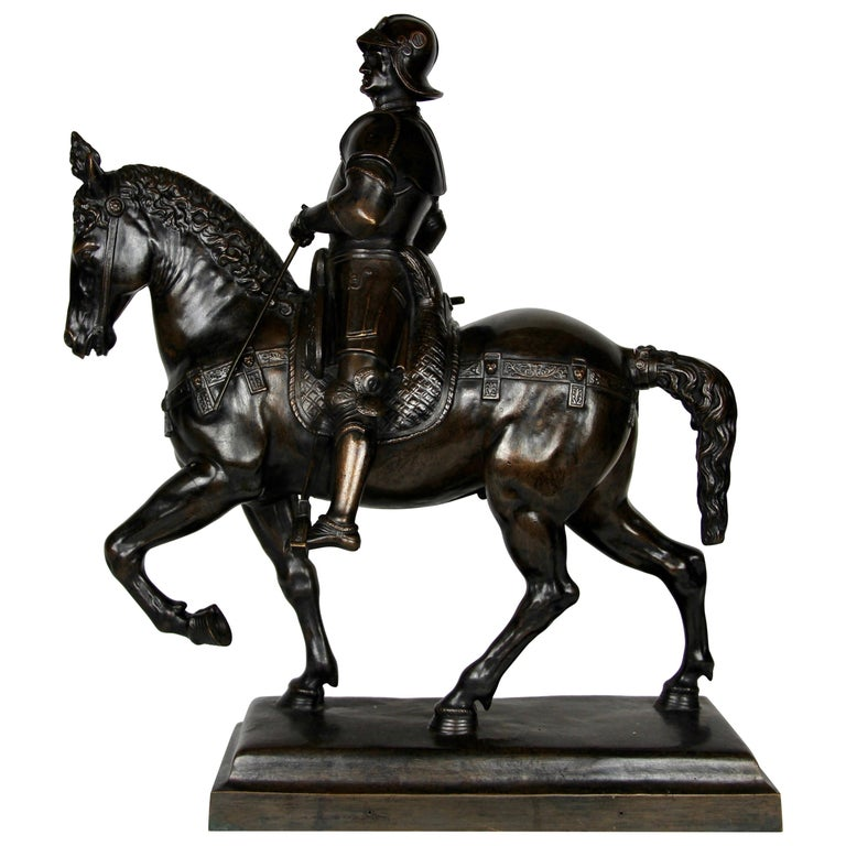 Patinated Bronze Figure of a Soldier on a Horse with a Helmet For Sale