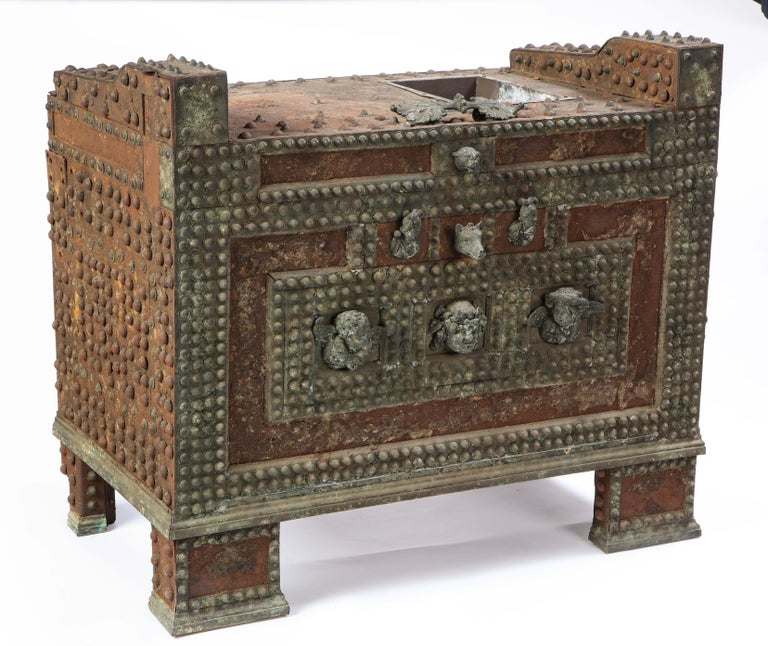 A 20th century patinated-bronze model of a safe based on an example from Pompeii . Said to be originally from the Andrew Carnegie collection, this is a truly distinct piece that can serve as an accent to any room. The small and intricate details