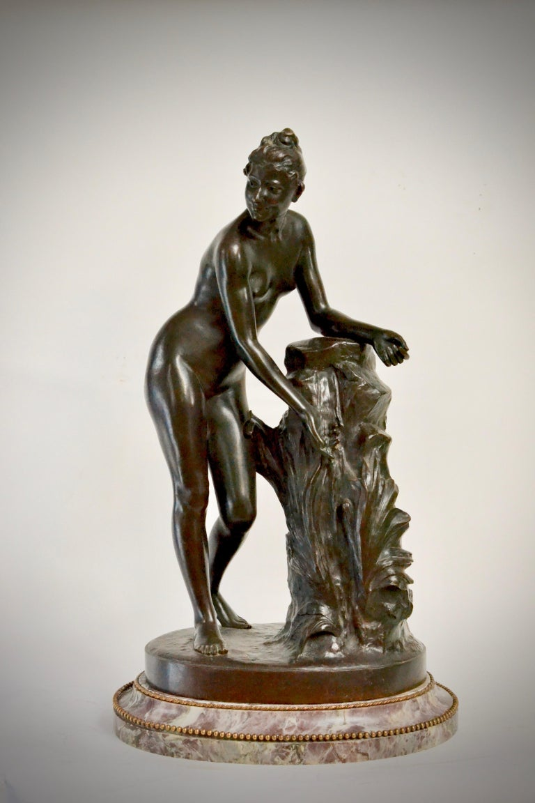 A second half of the 19th century patinated bronze sculpture of a standing woman signed Malvina Brach.