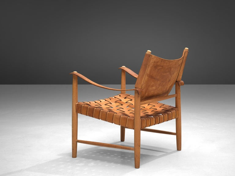 Safari chairs, patinated leather, beech, Denmark, 1950s