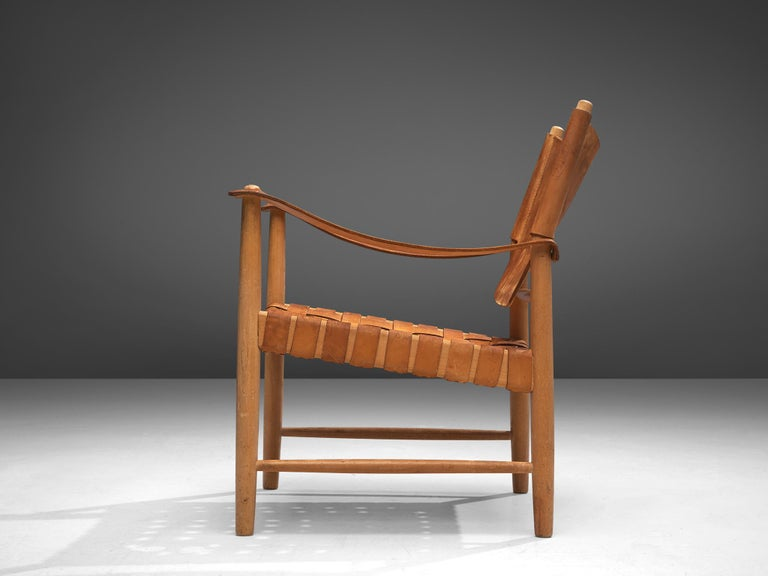 Danish Patinated Cognac Leather Safari Chair, Denmark, 1950s For Sale