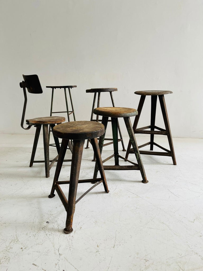Patinated Industrial Factory stools group of six, Austria, 1930s.