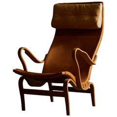 Patinated Leather Pernilla Lounge Chair by Bruno Mathsson