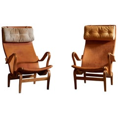 Patinated Leather Pernilla Lounge Chairs by Bruno Mathsson