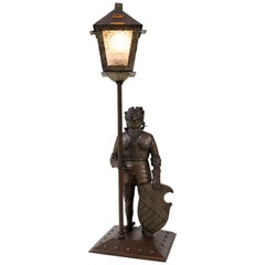 Patinated Metal Arts & Crafts Knight Table Lamp by Hugo Berger for Goberg, 1920s