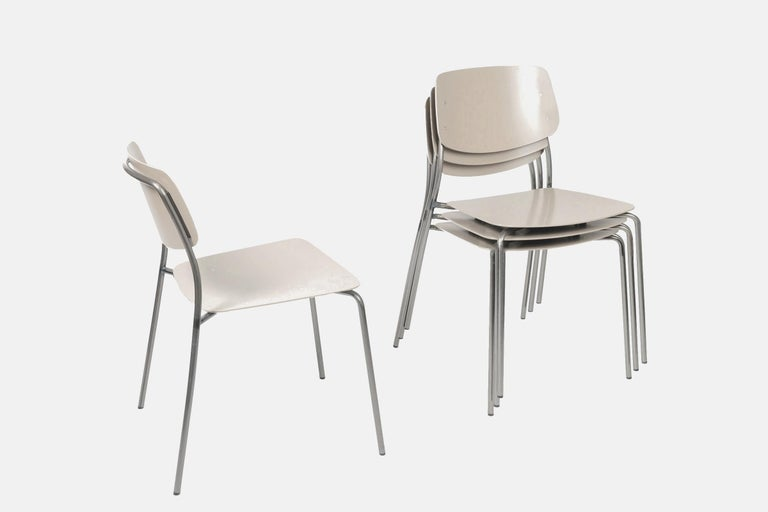 This set is a floor sample of 4 metal chairs and their matching folding table. They are weather resistant (water-resistant and UV resistant).  They are the outdoor version of the famous Felber collection by Dietiker, which is a modular product