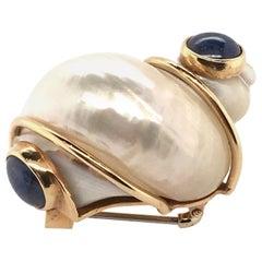 Patricia Schepps Vail for Seaman Schepps Shell, Gold and Sapphire Brooch
