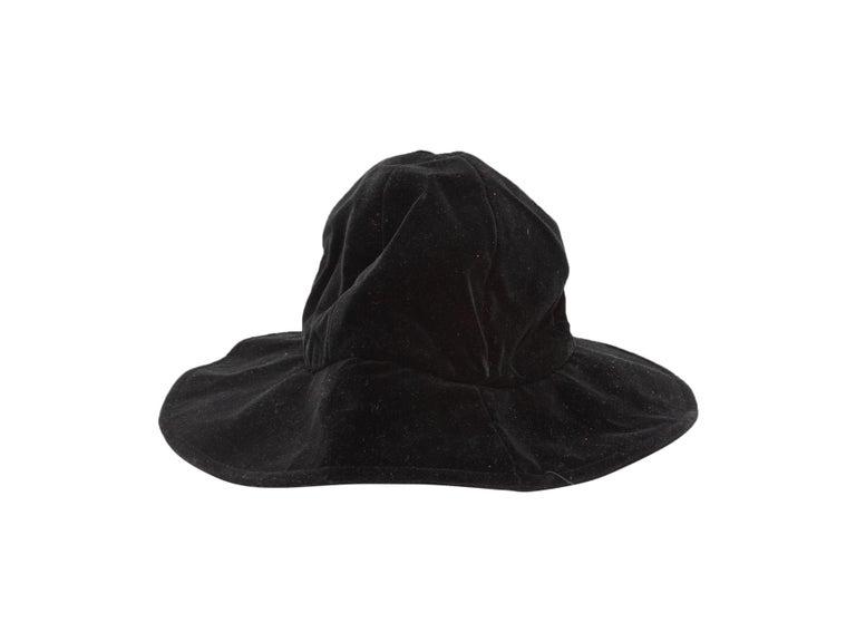 Product Details: Black velvet wide brim bucket hat by Patricia Underwood Too. 6.5