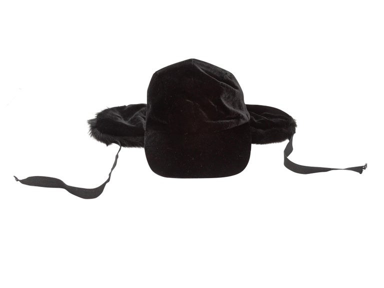 Product Details: Black velvet baseball cap with fur ear flaps by Patricia Underwood. 3.5