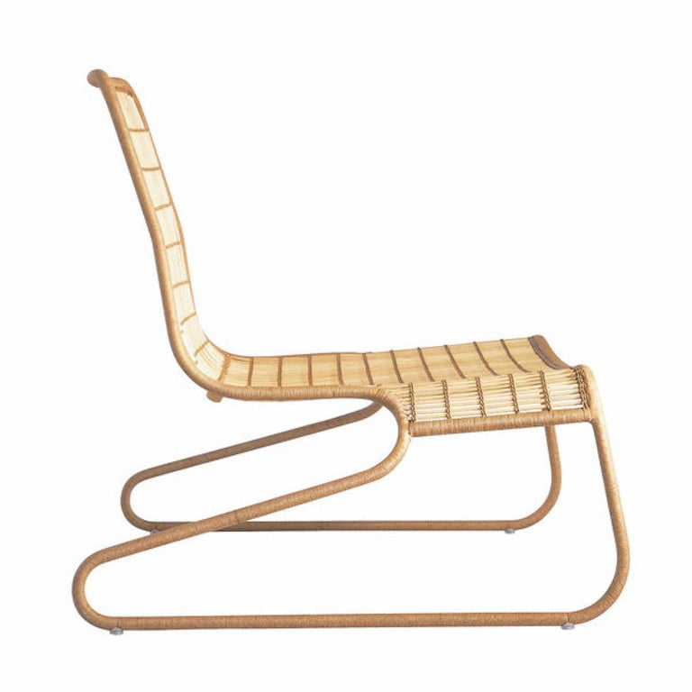 Flo armchair design by Patricia Urquiola for Driade with a painted steel structure covered in wicker in an 'aerial' version.