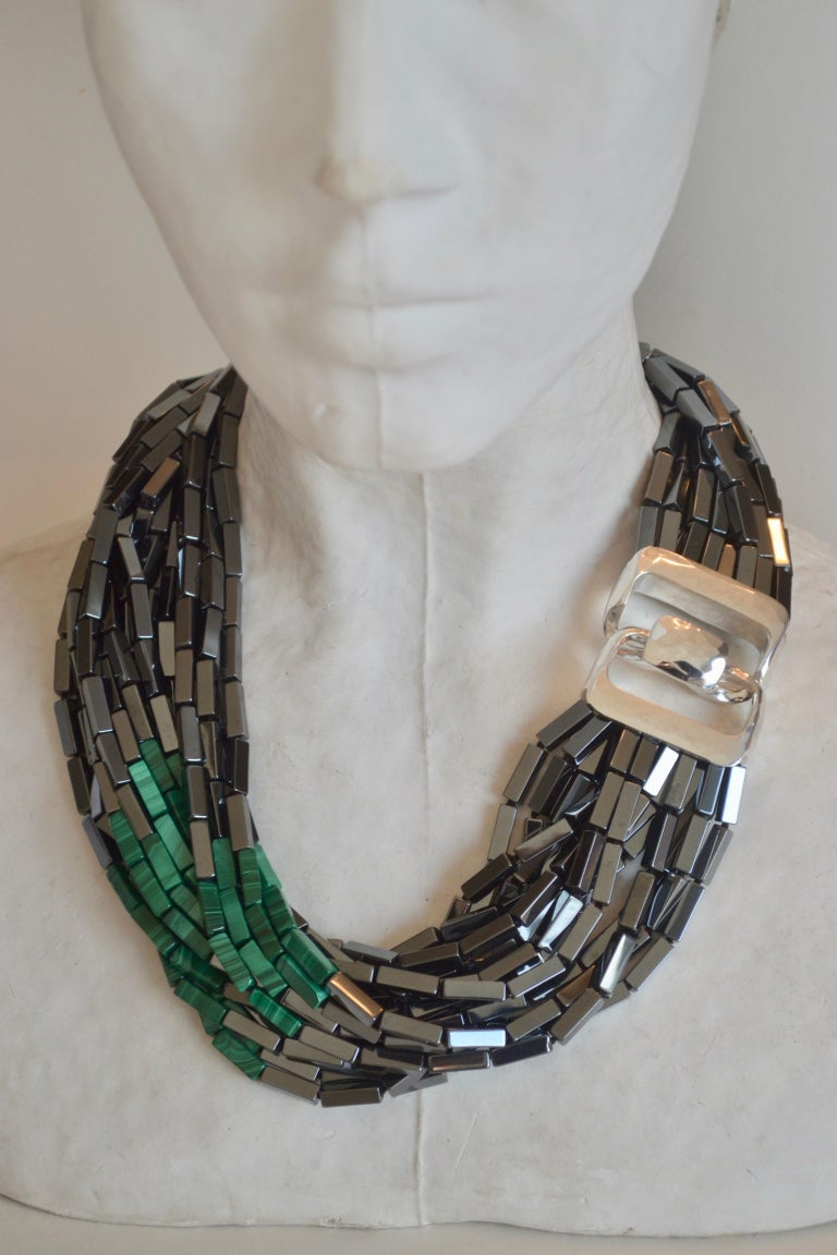 Sterling silver clasp with hematite and two side panels of green malachite (14 strands) from Patricia von Musulin.