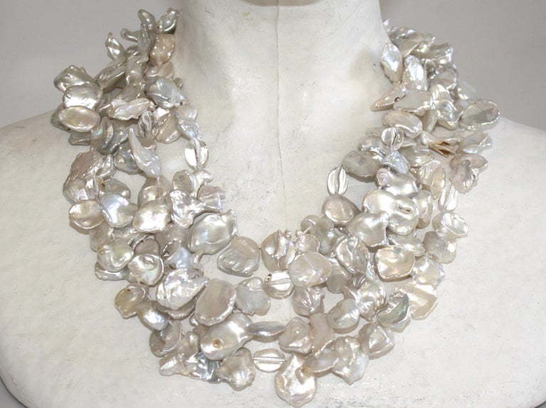 Patricia von Musulin necklace with 4 strands of baroque pearls, rock crystals, and a sterling silver signature clasp.
