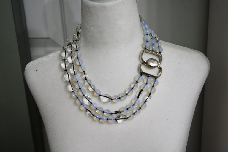 In this one of a kind from Patricia Von Musulin opaline and rock crystal beads are strung on black Japanese silk threads and finished with a sterling silver clasp.