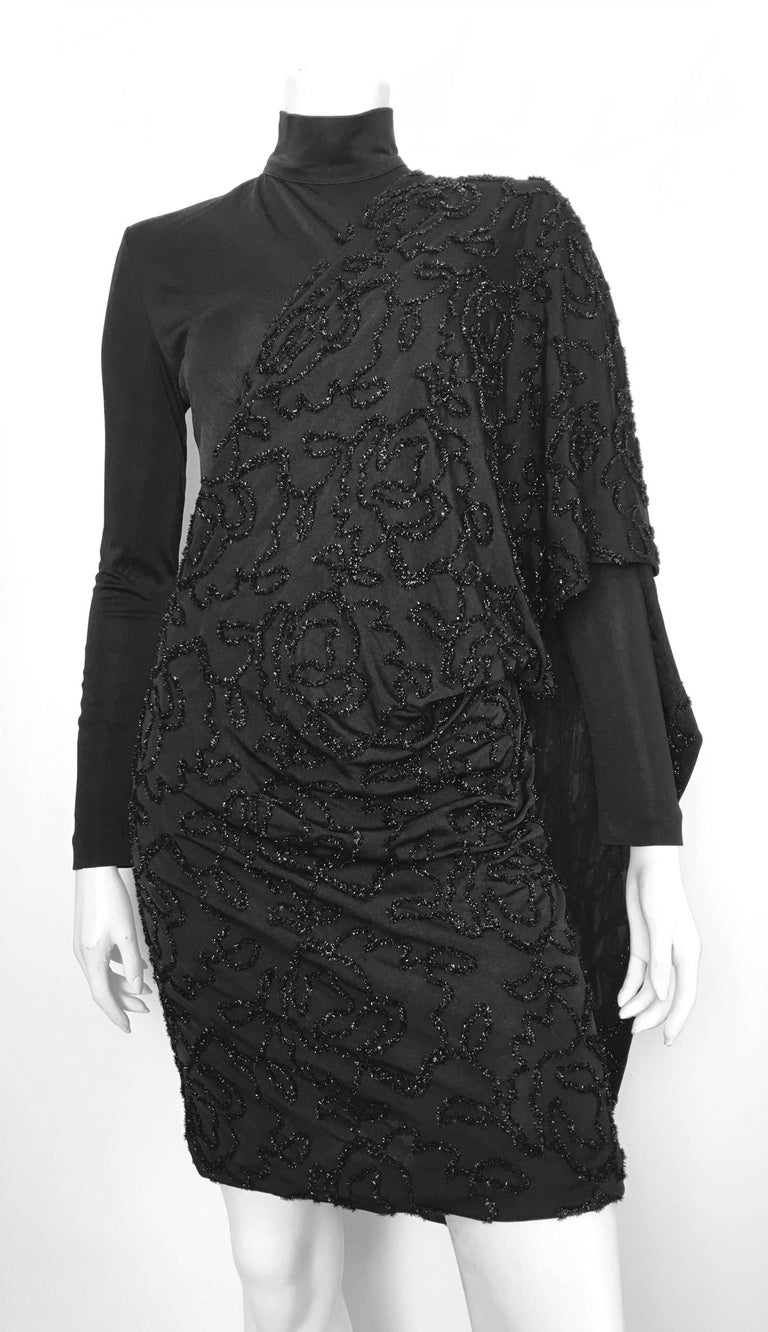 Patrick Kelly 1980s black long sleeves & turtleneck cocktail evening dress is labeled a size 10 but fits like a modern size 4 /6.  This dress is on Matilda the Mannequin and she is a size 4. There is some stretch to it due to the nylon & acetate