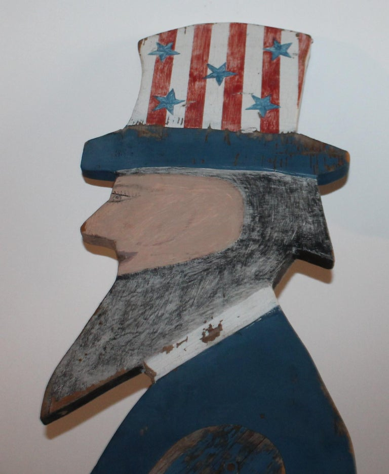 Handmade and painted Uncle Sam in all original painted surface.