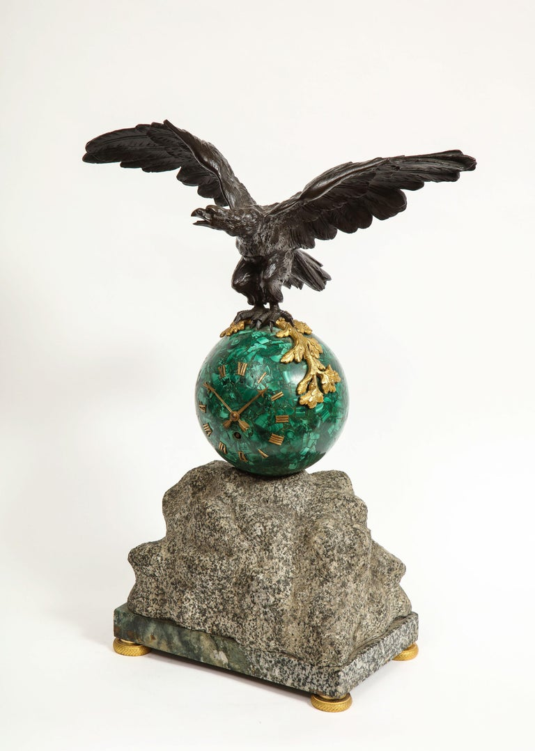 Patriotic French patinated bronze eagle and malachite clock on granite base, 1889.  Very nice clock with patinated bronze flying eagle sitting on a round malachite globe-form clock.   Unique piece. Clock with Roman numeral numbers sitting on a