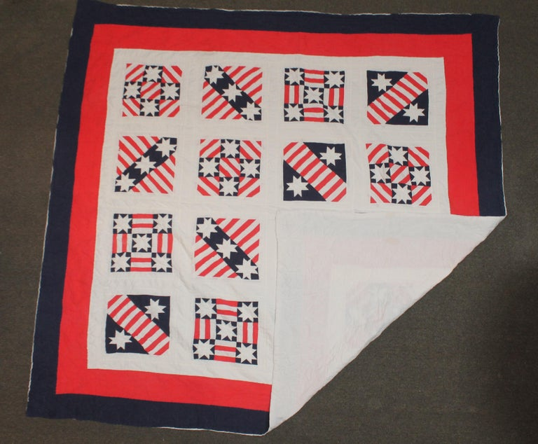 This fun patriotic red, white and blue quilt is in very good with slit fade condition in areas. It had a paper label with a signature and dated 1986. Late but great !!! A copy from the early 20th century with very nice quilting as well.