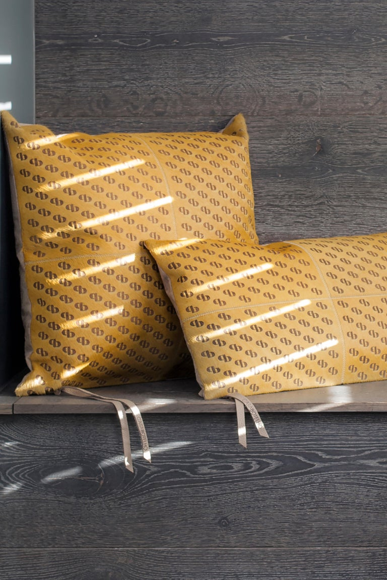 Casa Botelho hide collection is made from the finest materials with meticulous focus to details. The cushions are handcrafted using high quality, carefully selected, and sustainably sourced cow hides. Luxe skins in rich, jewel tones are hand-dyed,