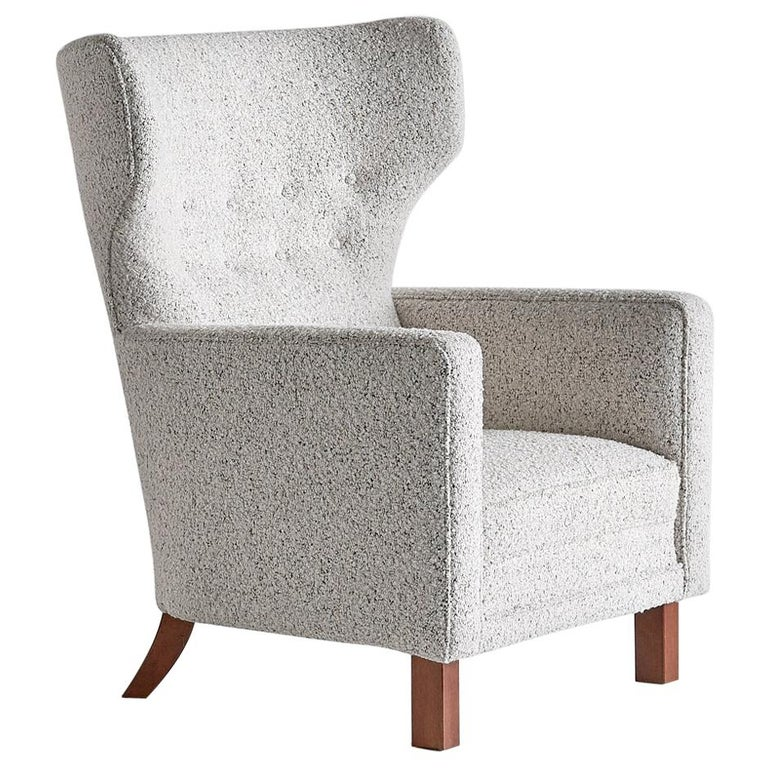 Paul Boman Wingback Chair in Pearl Bouclé Fabric and Beech, Finland, 1940s For Sale