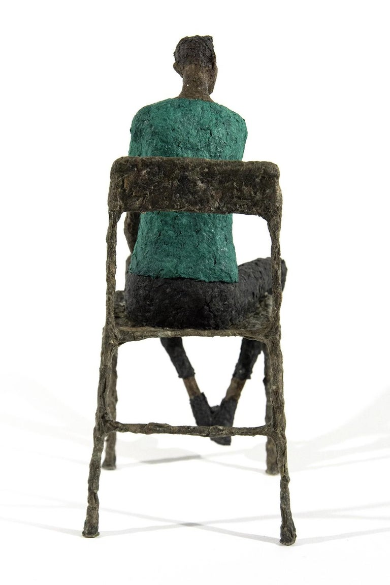 Quebecois sculptor Paul Duval has created a series of expressive paper mache and wire figurative sculptures. Each one exudes a different personality evident in their posture, gesture, and colour.   A seated figure in a blue-green waits quietly in