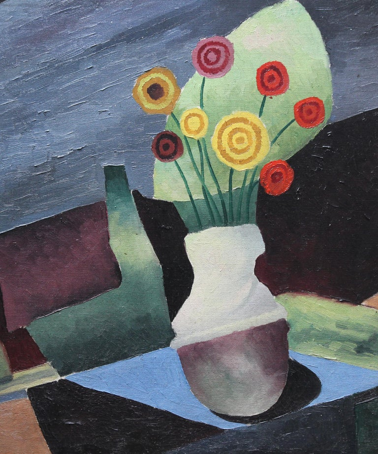 This appealing original oil on canvas is by British artist Paul Earee. Painted in a Post Cubist manner circa 1930, this floral still life depicts a vase of flowers on a table in bold blocks of colour. A really vibrant painting in superb tones.