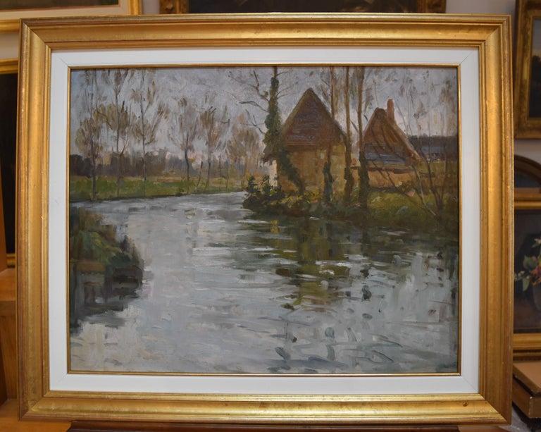 Paul Emile Lecomte (1877-1950)  A river landscape, Oil on panel - Post-Impressionist Painting by Paul Emile Lecomte