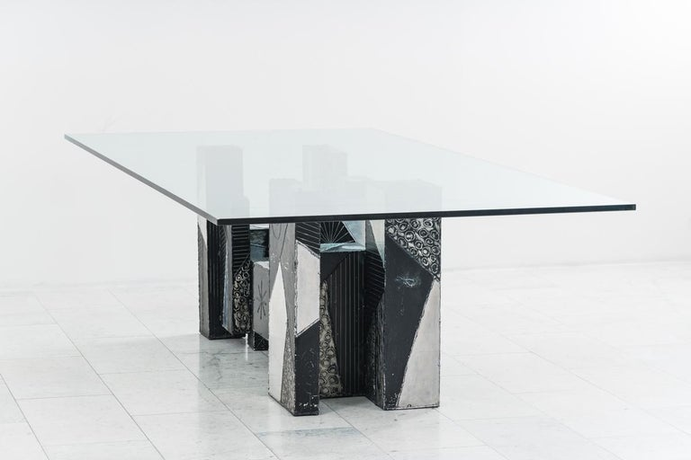 A popular form that Paul Evans would revisit through his career is a composition he called Skyline. Skyline pieces, such as this magnificent unique dining table, were comprised of individually hand-welded boxes of varying heights, shapes, textures