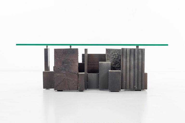 Paul Evans Studio-sculpted bronze coffee table. Vertical planes featuring different decorative motifs. Measures: Base without glass (approximate) 41