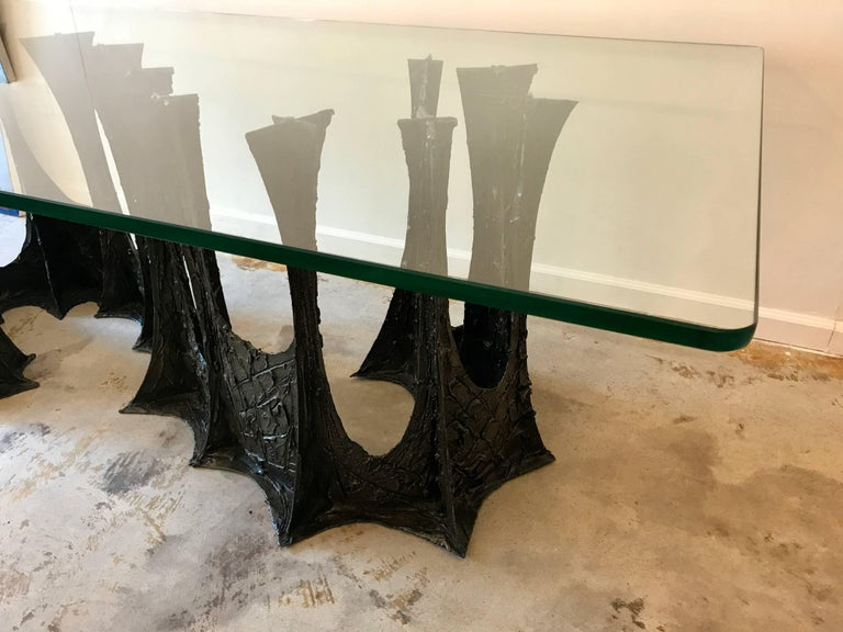 A spectacular and very rare sculptural brutalist Paul Evans stalagmite base dining table, model PE102, signed PE70. The bronze and resin composite base is in extraordinary condition and shows beautifully with its deep dark bronze patina. The table