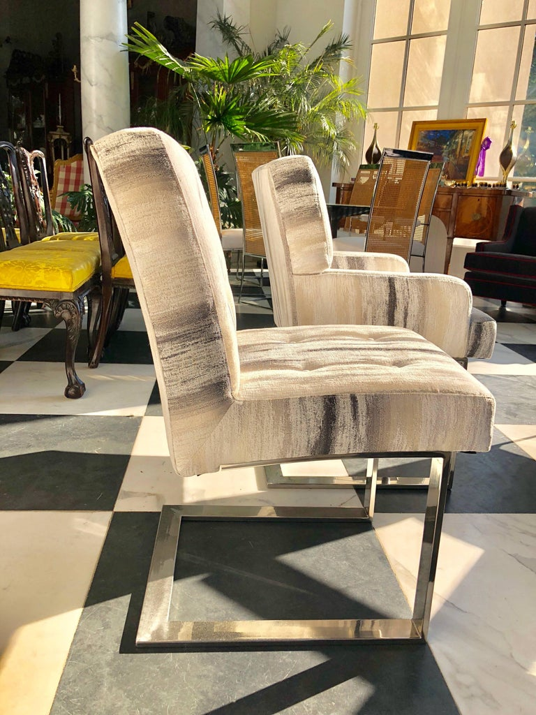 A wonderful set of six Paul Evans chrome cantilever dining chairs. There are two arm chairs and four side chairs. Two have been newly upholstered in a contemporary cotton fabric simulating the bark of a birch tree, but is soft to the touch. If so