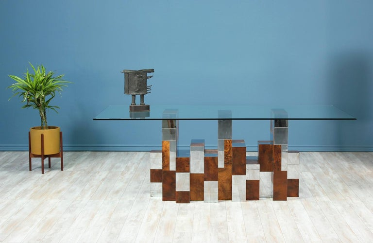 Striking dining table designed by Paul Evans for Directional in the United States circa 1970's. This sophisticated design is part of the Cityscape series created by Evans and is said to mimic the New York City skyline. The table maintains its