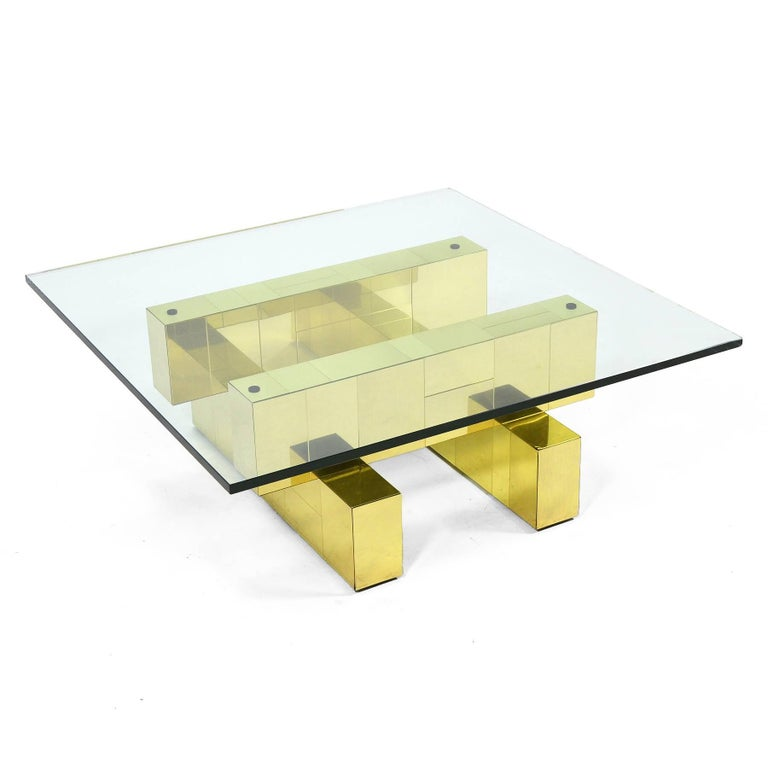 This table from Evans' PE200 series features a strong architectural quality and is clad in a brass patchwork.