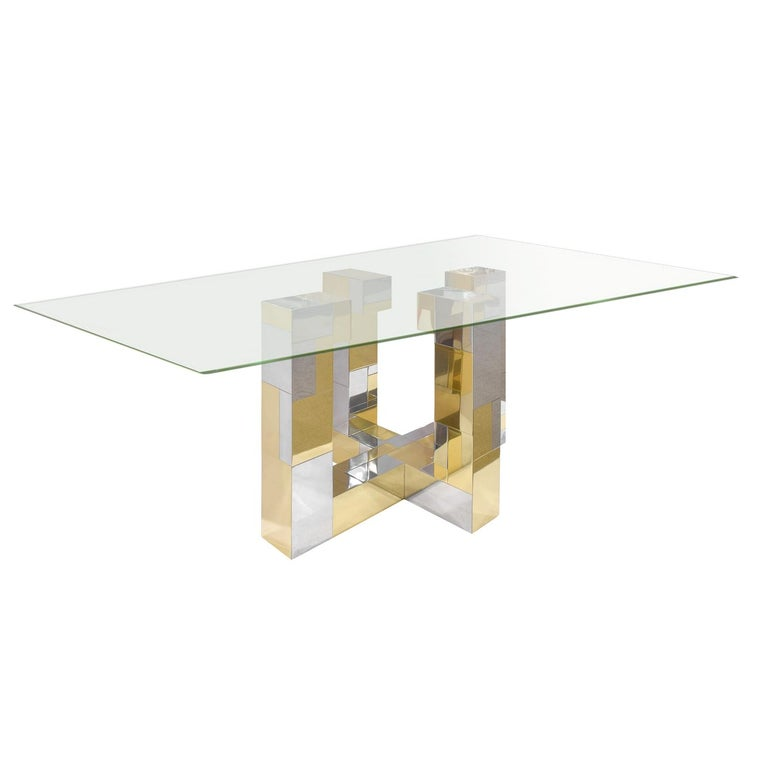 Dining table with base in tessellated chrome and brass with thick glass by Paul Evans for Directional Furniture, Cityscape Collection, American, 1970s. This is a rare form.