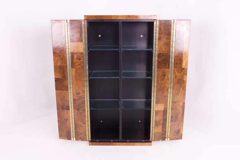 Paul Evans midcentury burl wood floating display cabinet.  Measures: 24.5 wide x 13.75 deep x 48.25 high.  Veneer Loss.  All pieces of furniture can be had in what we call Restored Vintage Condition. That means the piece is restored upon purchase so