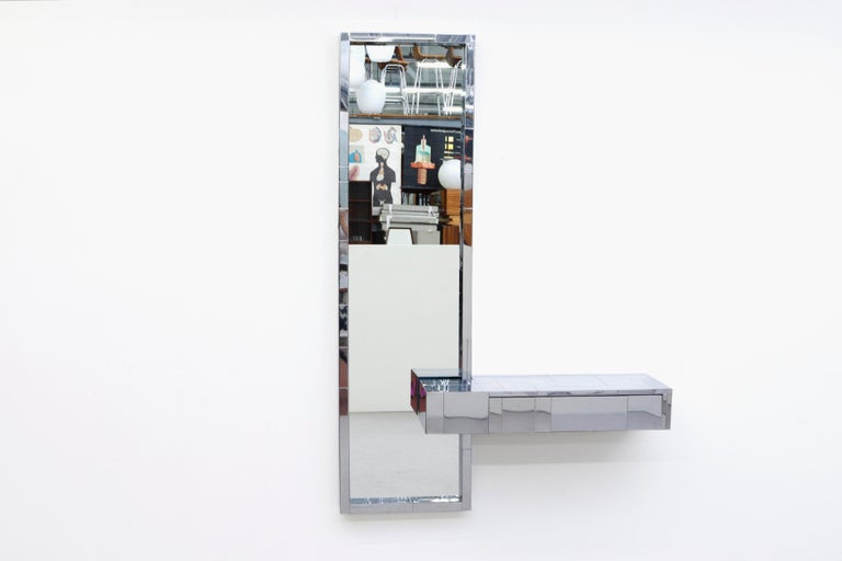 Paul Evans cityscape mirror with floating console or vanity. Chrome frame in original condition with some frame wear and scratching. Vanity measures: 36 x 12 x 6. Shown with Pilastro wire stool (LU922415664511) listed separately.