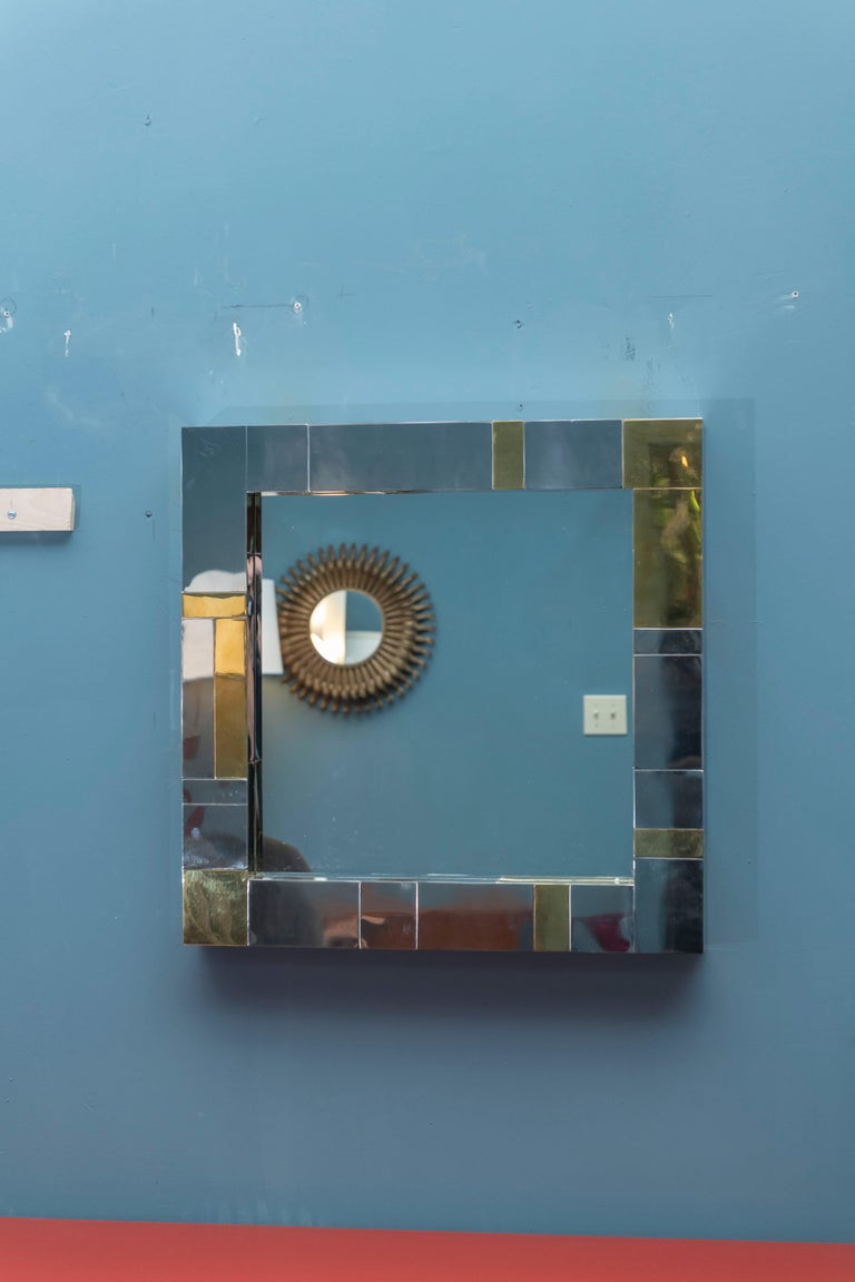 Paul Evans Cityscape wall mirror in a chrome and brass patch work design.