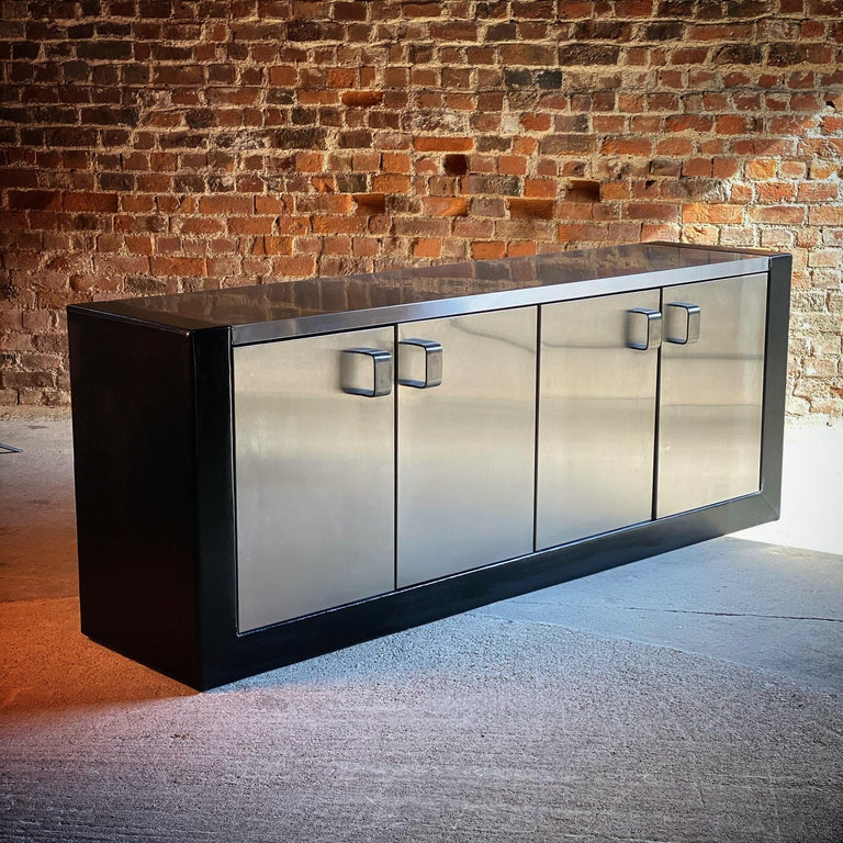 Paul Evans custom steel sideboard credenza, USA, circa 1970  Paul Evans (1931-1987) custom stainless steel and leather clad sideboard USA 1970s, a custom sideboard with leather upholstered sides and base and brushed and polished stainless steel