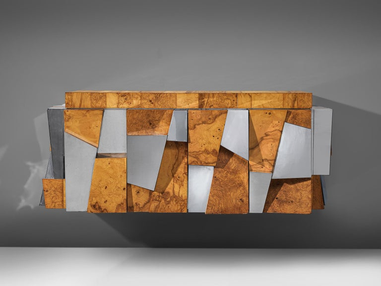 Paul Evans for Directional, 'Faceted' wall-mounted cabinet, chromed steel, olive ash burl, glass, United States, 1970s  A beautiful wall-mounted sideboard by Paul Evans for Directional. The piece is an excellent example of how Evans' Cityscape