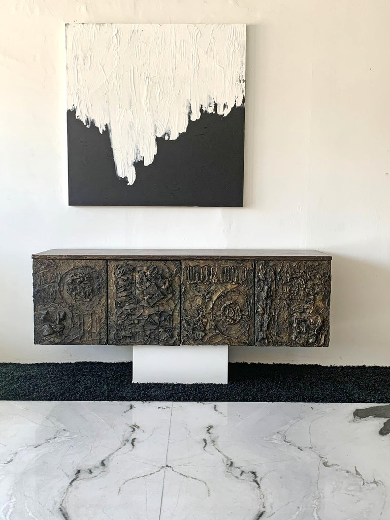 This piece is incredible! A sculpted cast bronze cabinet by Paul Evans for Directional furniture. This