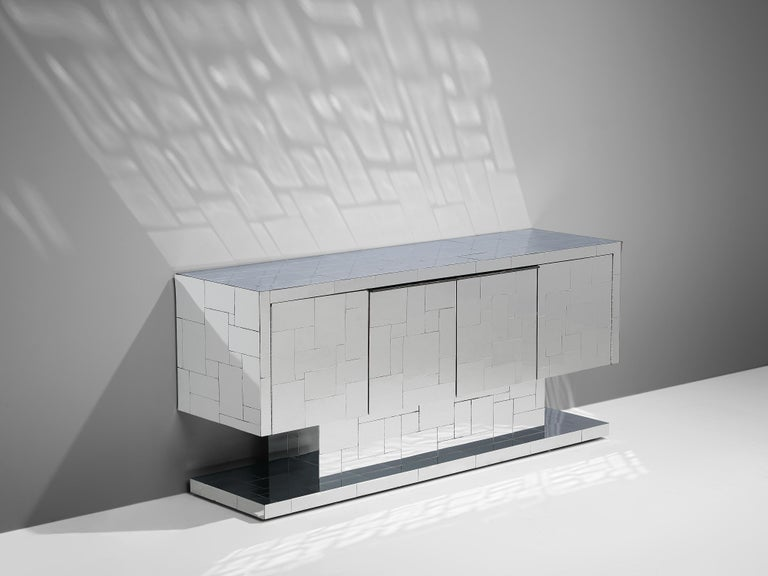 Paul Evans for Directional, 'Cityscape' sideboard, chrome on wood, United States, circa 1972  A two-doors credenza designed by Paul Evans. A real eyecatcher which interacts with its surroundings and the reflection of the light. The sideboard is