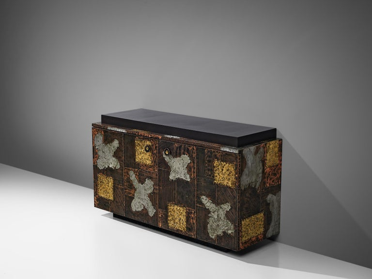 Paul Evans for Directional, 'Patchwork' sideboard, wood, fiberglass, copper, steel and brass, United States, 1960s  Unique sideboard designed by Paul Evans for Directional furniture. The wheeled cabinet is made of copper, steel and brass and