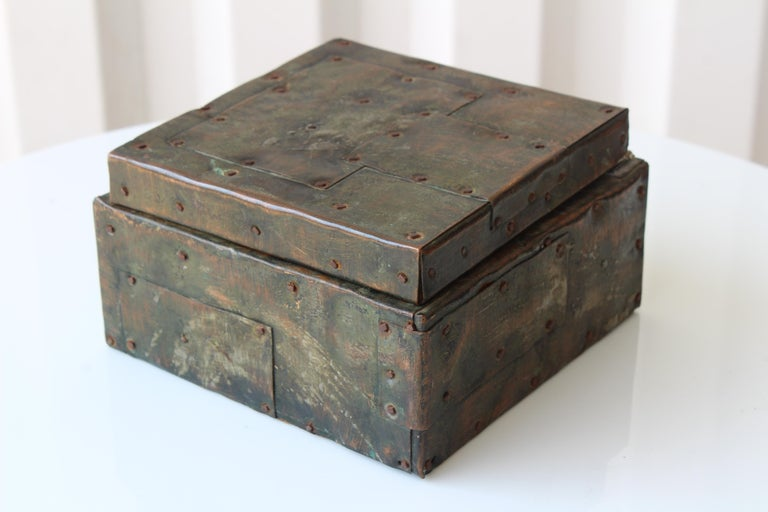 Metal clad lidded box by Paul Evans, U.S.A, 1965. Brass, copper and steel. Shows age appropriate wear with some cork missing in the interior of the box.